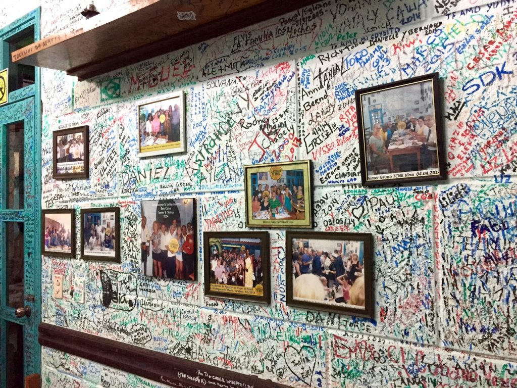 A wall inside La Bodeguita del Medio in Varadero, Cuba - Passports and Spice