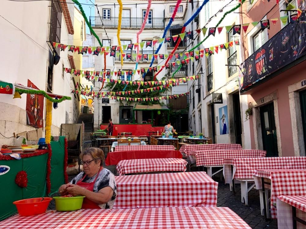Alfama neighborhood during Lisbon Sardine Festival - Passports and Spice