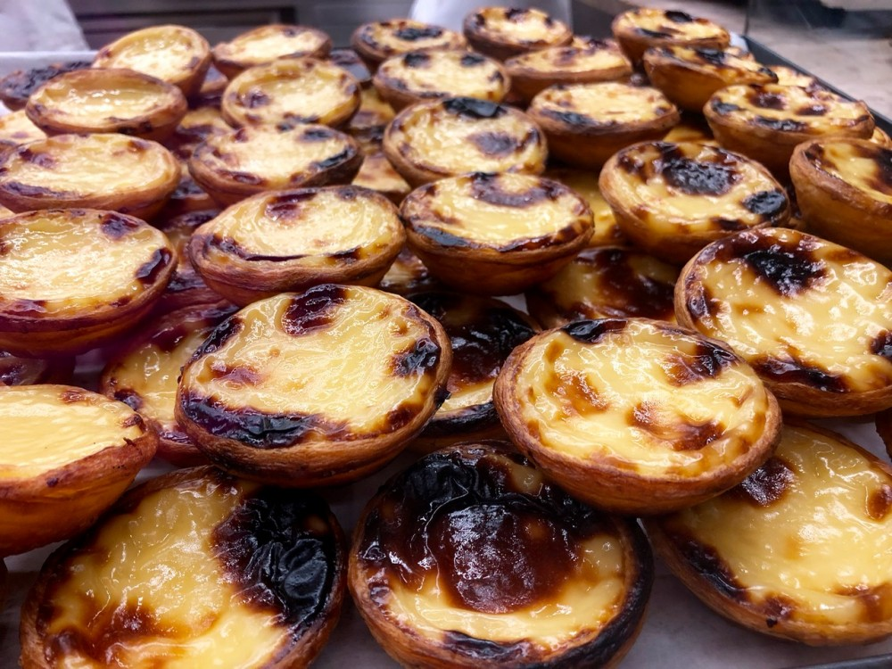 Pastel de nata are Lisbon's most famous pastries - Passports and Spice